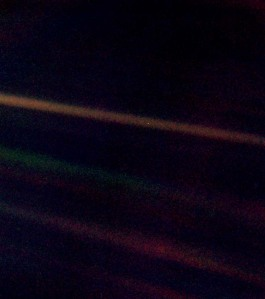 "On February 14, 1990, NASA commanded the Voyager 1 spacecraft, having completed its primary mission, to turn around to photograph planet Earth from the edge of our solar system, nearly 4 billion miles away. Caught in the center of scattered light rays from the Sun, planet Earth appears as a tiny point of light, a crescent only 0.12 pixel in size. This grainy photo of Earth has become known as the ""pale blue dot."""